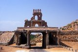 Hampi is a village in northern Karnataka state. It is located within the ruins of Vijayanagara, the former capital of the Vijayanagara Empire. Predating the city of Vijayanagara, it continues to be an important religious centre, housing the Virupaksha Temple, as well as several other monuments belonging to the old city.